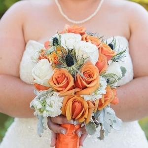 orange bouquet on The Budget Savvy Bride