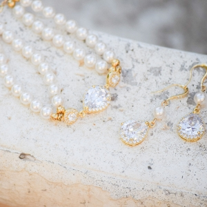 The Bridal Boutique  Gold + Pearl Bridal Jewelry Set by Estylo Jewelry