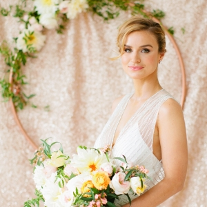 Gorgeous bride in front of rose gold backdrop, Betsi Ewing Photopraphy
