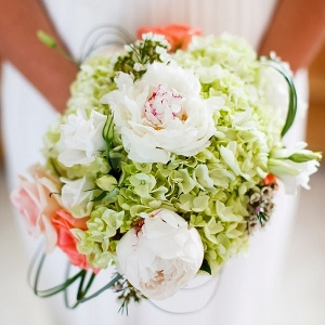 Green and coral bridal bouquet