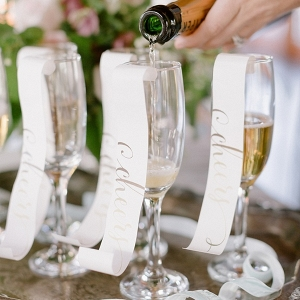 Calligraphy paper curls for champagne flutes