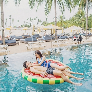 Newlyweds on pool float