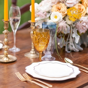 Mustard colored glassware and candles