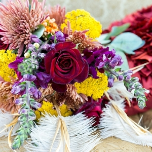 Colorful bridal bouquet with ostrich feathers