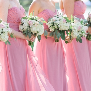 Pink bridesmaid dresses and bouquets
