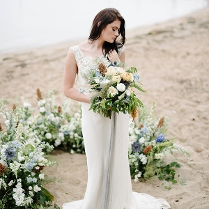 Coastal romantic bride with ceremony floral ring