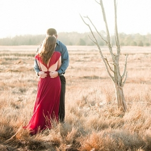 Engaged couple with gorgeous red dress