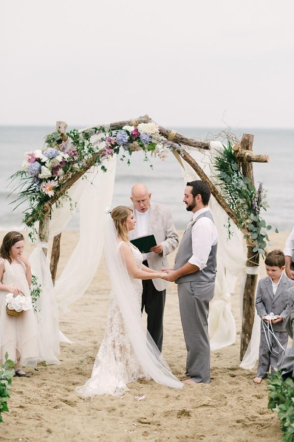 Beach wedding with ceremony arch