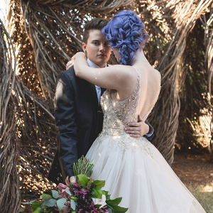 Two brides in a garden wedding
