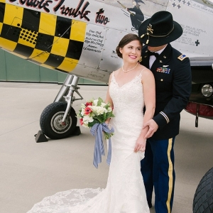 Bride and military groom at aviation museum