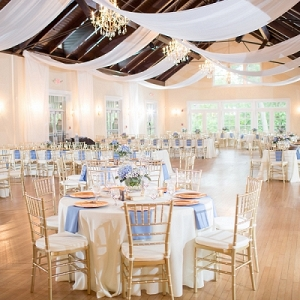 Gold and blue wedding reception with draping