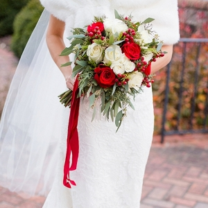 Christmas wedding bouquet with red velvet ribbons