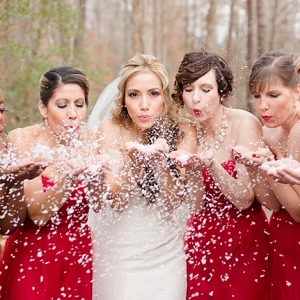 Red bridesmaid dresses and snow confetti