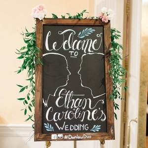 Chalkboard wedding sign with silhouettes