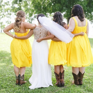 Bridesmaids in yellow dresses and cowboy boots