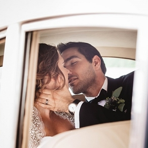 Bride and groom in classic car