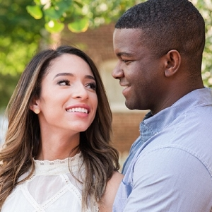 Engaged couple smiling