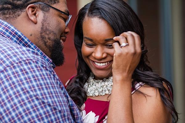 Sweet engaged couple laughing