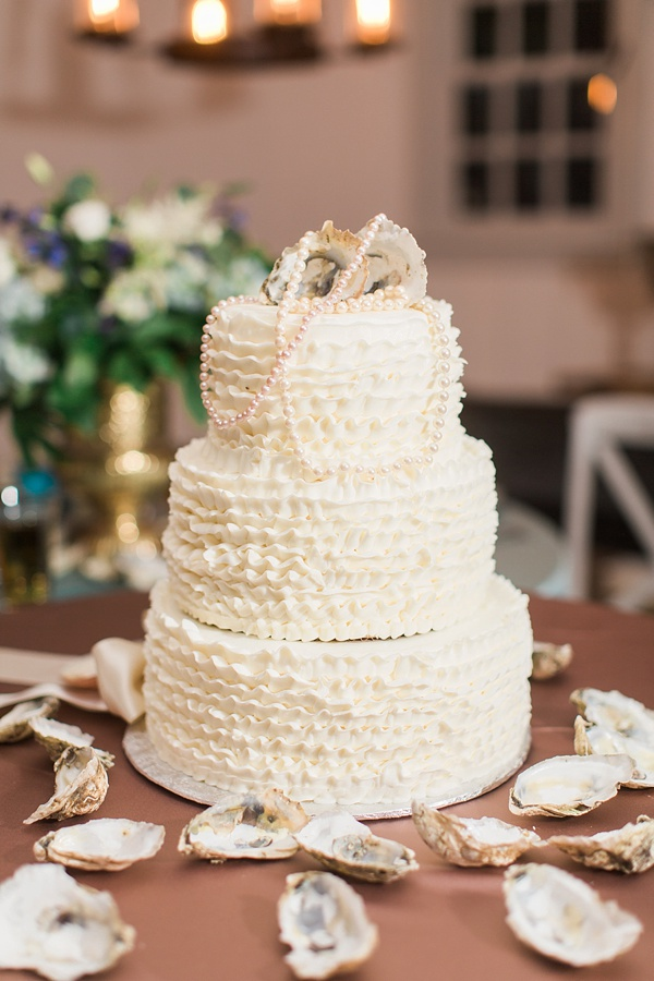 Wedding cake with oyster shells and pearls