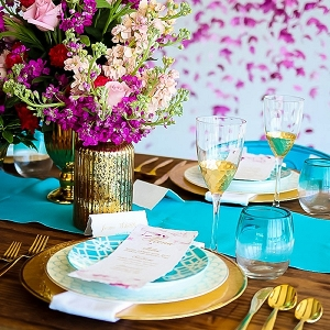 Turquoise and purple and gold wedding tablescape