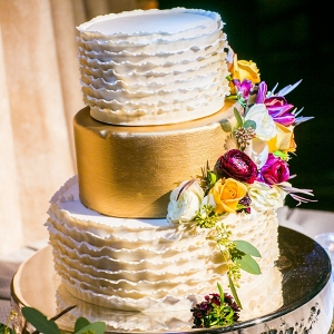 Ruffled gold painted wedding cake