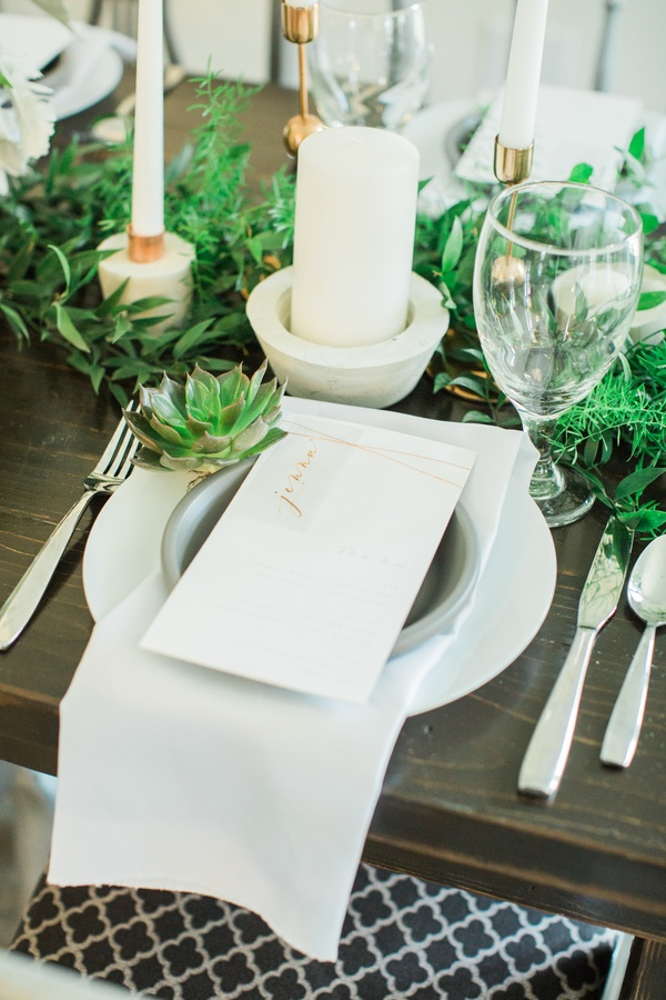 Modern greenery wedding tablescape with gold menu