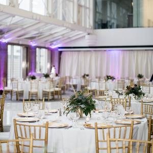 Classic wedding ceremony with greenery centerpieces