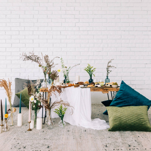 Modern boho wedding table with floor pillows