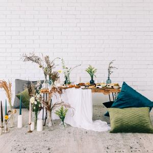 Modern boho wedding table with floor pillows