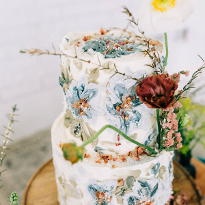 Floral print painted frosting wedding cake
