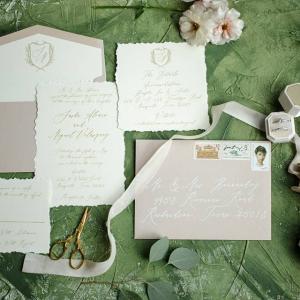 Calligraphy wedding invitation with crest