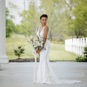Classic black bride in lace v-neck wedding dress