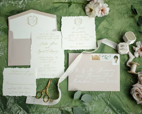 Calligraphy wedding invitation with crest