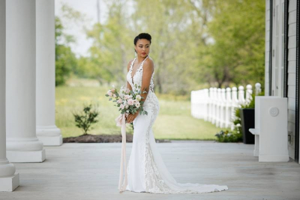 Classic black bride in lace v-neck wedding dress