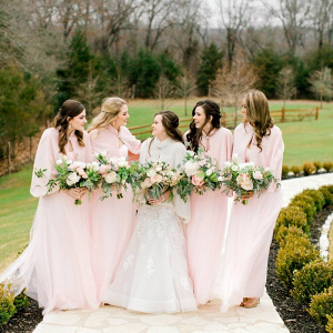 Winter bridesmaids in blush fur wraps