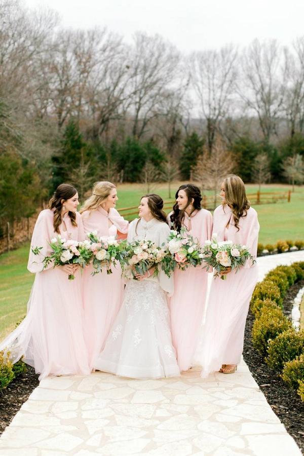Winter bridesmaids in blush fur wraps