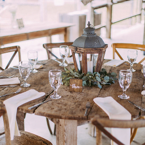 Rustic wedding table with lantern centerpiece