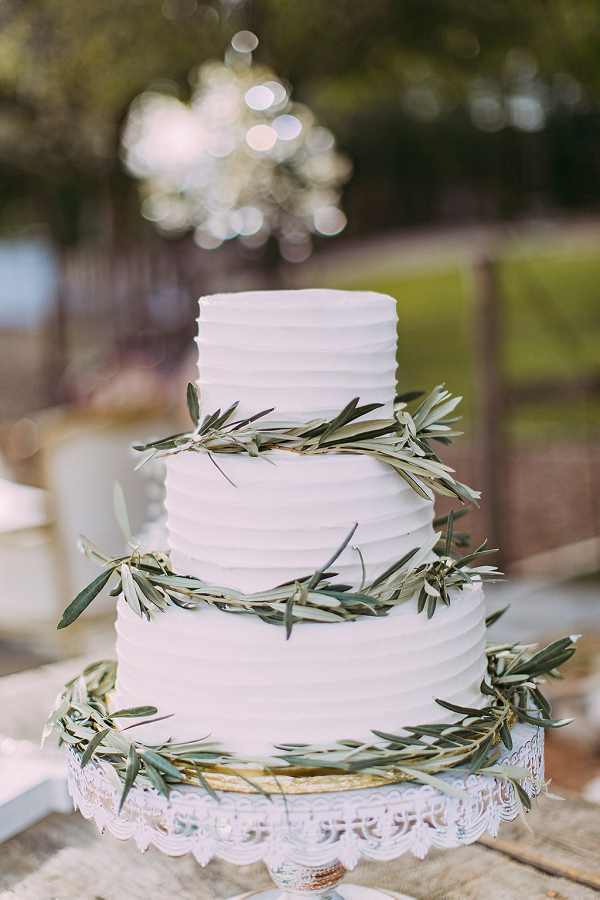 Classic white wedding cake with greenery