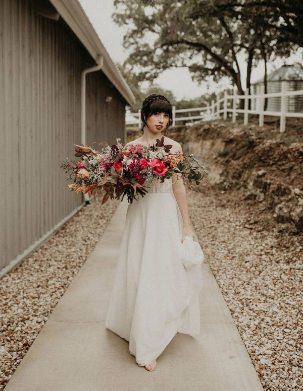 Bride with lush fall bouquet