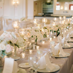 Elegant long table wedding reception with blush and cream florals