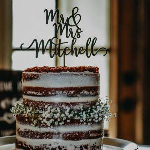 Semi naked wedding cake with baby's breath