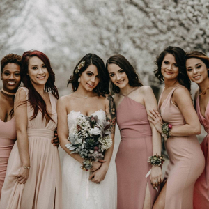 Bridesmaids in mismatched blush dresses