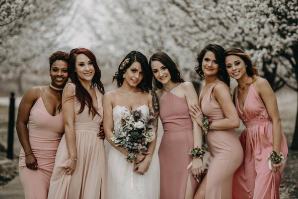 Bridesmaids in mismatched blush dresses