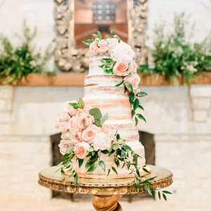 Semi naked wedding cake with fresh pink florals