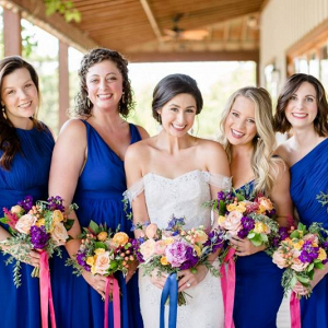 Bridesmaids in bright blue dresses