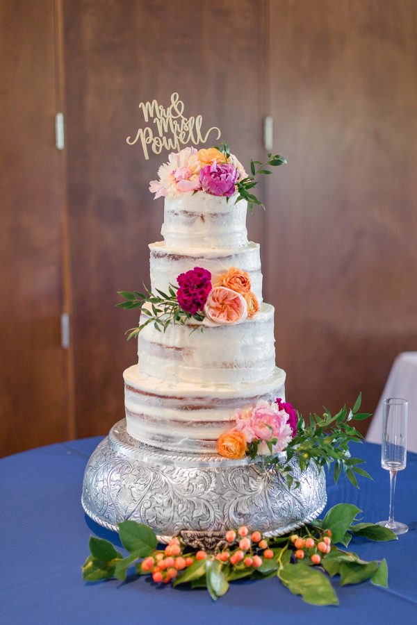 Classic semi naked wedding cake with fresh flowers