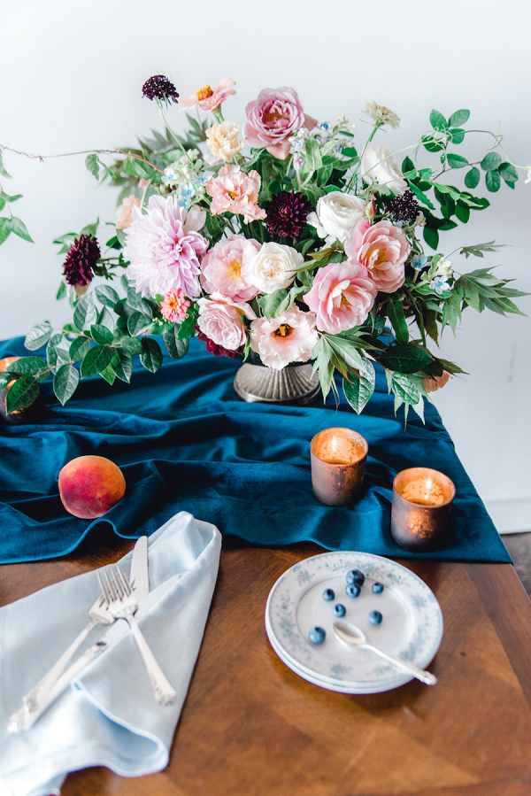 Lush wedding tablescape with velvet linens and pink centerpiece