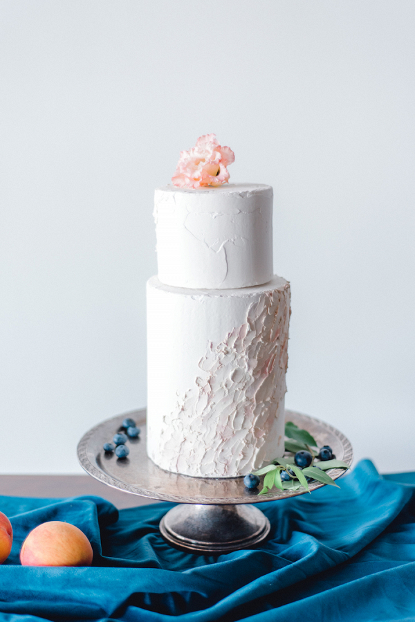 Blush painted wedding cake