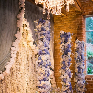 Floral draping and column ceremony backdrop