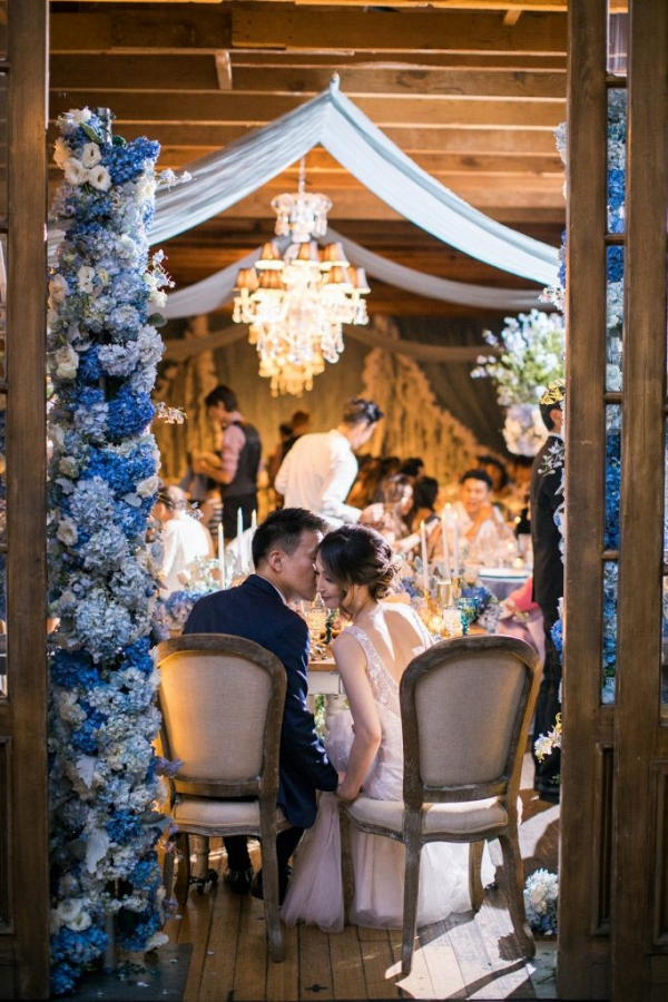 Luxe wedding reception with blue floral decor